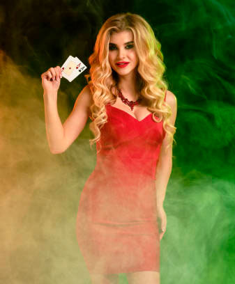 Girl in red with cards in a hookah bar.