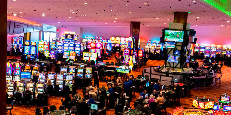 Casino hall with slot machines and visitors